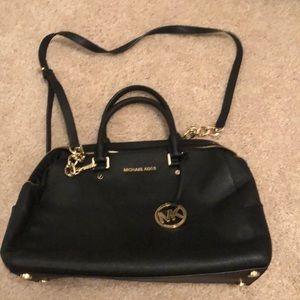 Black Michael Kors purse with dust bag